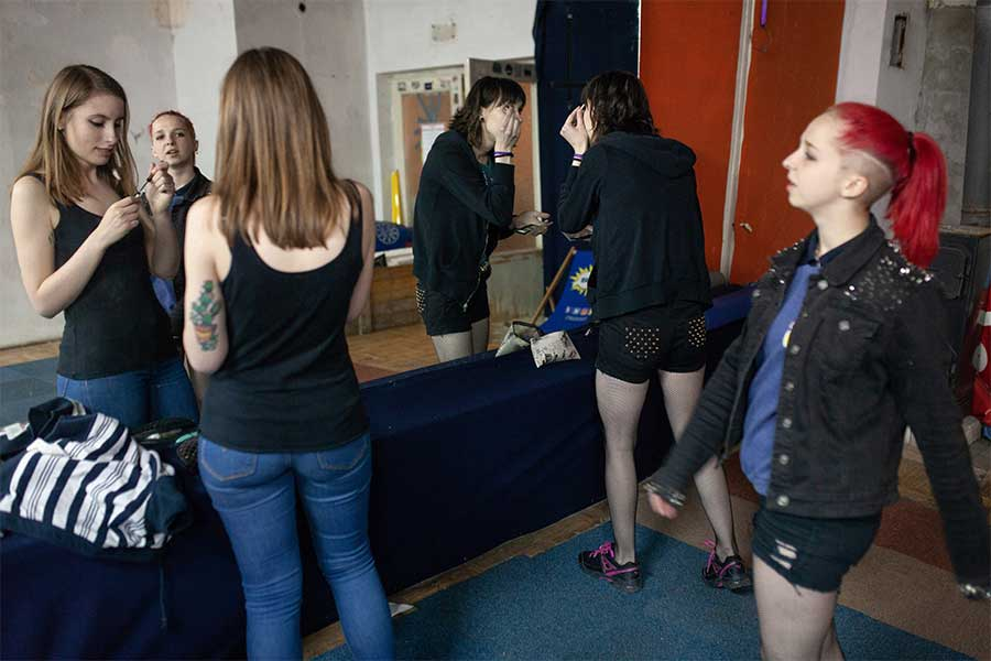 Messed up girls are getting ready for their concert at the Warsaw from the series 100% girls punk-rock from East Europe by  Evgeni Attsetski