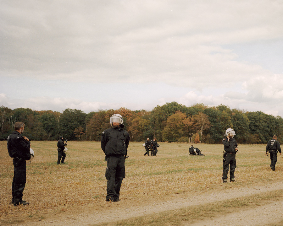 Police arrest protesters from the series In a light that is leaving by Neha Hirve
